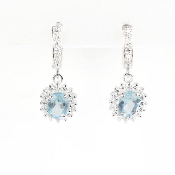 Сережки – підвіска на англійскому замку, овальний блакитний топаз в обрамлені фіанітів