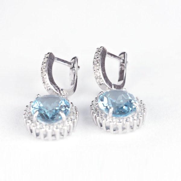 Сережки – підвіска на англійскому замку, овальний блакитний топаз в обрамлені фіанітів фото 2