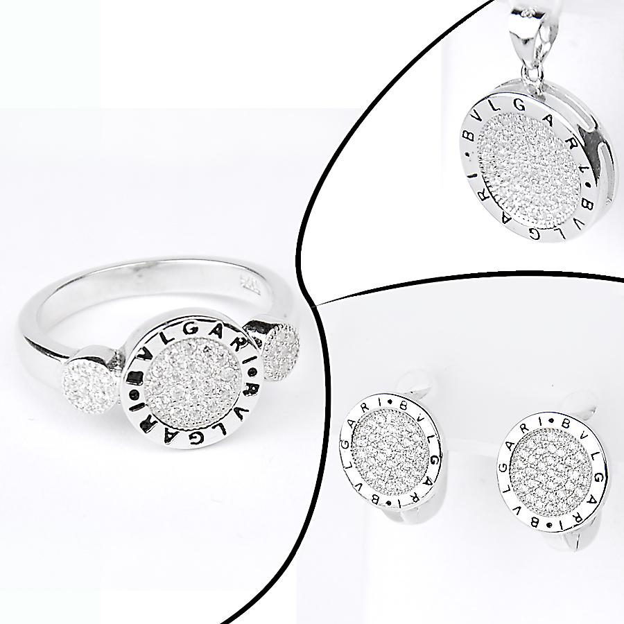 каблучка, та срібні сережки в стилі Bvlgari
